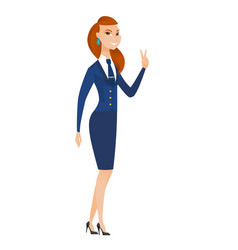 Caucasian stewardess showing the victory gesture vector