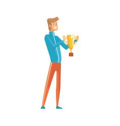handsome young sportsman holding winner trophy vector image vector image