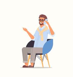 businessman sitting on armchair using smartphone vector image