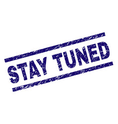 Scratched textured stay tuned stamp seal vector