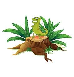 A green iguana above a trunk vector image vector image