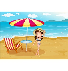 A woman wearing a stripe swimsuit at the beach vector image vector image