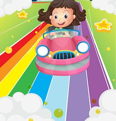 A little girl riding in a pink car vector image