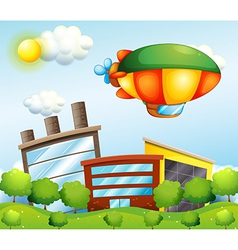 A tri-colored airship at top buildings vector