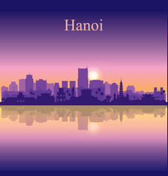 Hanoi city silhouette on sunset background vector