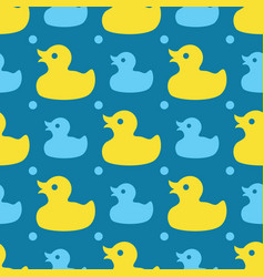 seamless pattern with yellow rubber ducks on a vector image
