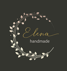 premade logo design with golden floral wreath vector image