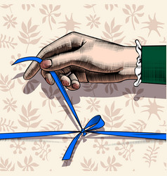womans hand untying bow of blue ribbon vector image