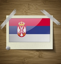 Flags Serbia at frame on wooden texture vector image