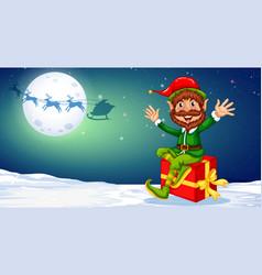 Happy christmas elf sitting on gift vector