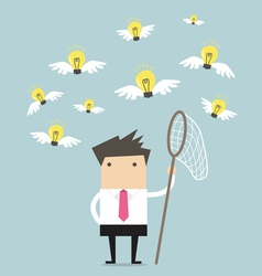 Businessman trying to catch a light bulb idea vector