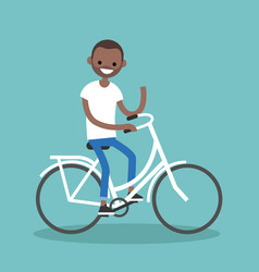 young black man riding a bike and waving his hand vector image vector image