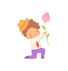 Cute kneeling little boy giving pink rose flower vector