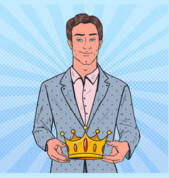 Pop art man holding golden crown firts place vector