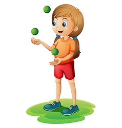 A young girl playing with the three green balloons vector