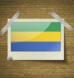 Flags Gabon at frame on a brick background vector image