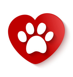 Paw print over heart shape vector