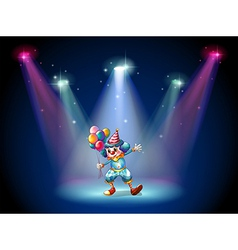 A clown at the center of the stage vector image