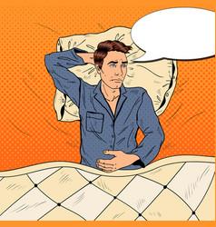 Pop art man in bed suffering insomnia vector