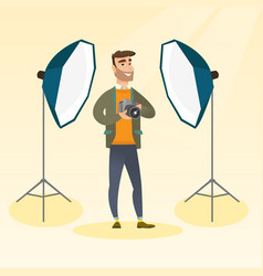 Photographer with a camera in a photo studio vector