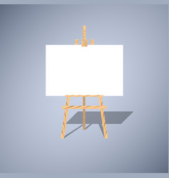 wooden easel with a white blank canvas vector image