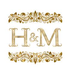 h and m vintage initials logo symbol vector image