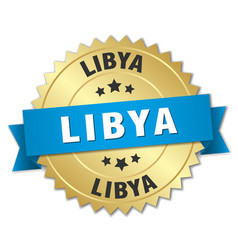 Libya round golden badge with blue ribbon vector