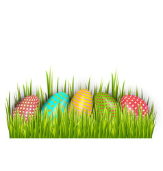 row of easter painted eggs hidden in green grass vector image