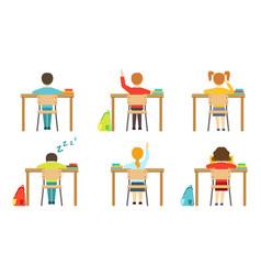 Schools pupils sitting at desks at classroom view vector
