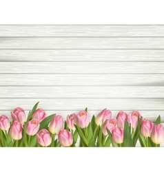 Colorful tulips on wooden table EPS 10 vector
