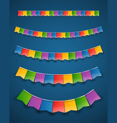 color paper flags garlands on dark background vector image