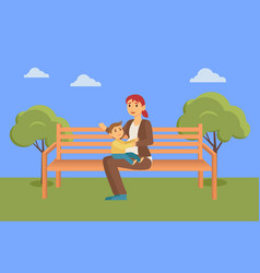 Mother sit on bench and feed son in summer park vector