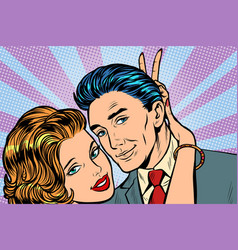 woman puts horns to man hand gesture joke vector image