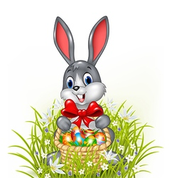 A Easter bunny with a basket of painted Easter egg vector image