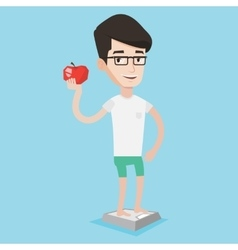 Man standing on scale and holding apple in hand vector
