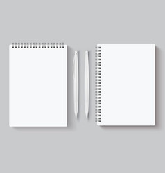 Realistic spiral notebooks blank notepad and pen vector
