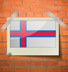Flags Faroe Islands scotch taped to a red brick vector