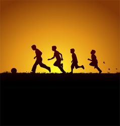 Running boys with the ball vector image