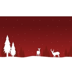 Silhouette of deer and spruce on red backgrounds vector image vector image