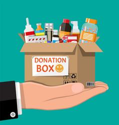Cardboard box full drugs in hand vector