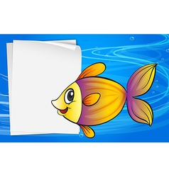 A fish beside an empty signboard vector