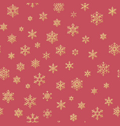 gold snowflakes seamless pattern on a red vector image