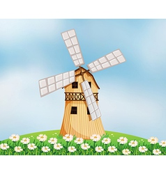 A barn with a windmill vector image