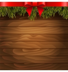 Christmas tree red bow on the wood background vector image vector image