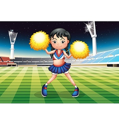 A cheerleader dancing in the stadium with her vector image