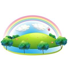 A rainbow at the hill vector
