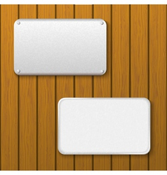 Two metal plates on a wooden wall vector