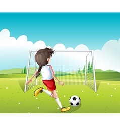 A female soccer player in a white uniform vector image