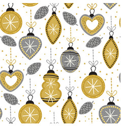 Seamless pattern with gold christmas decorations vector