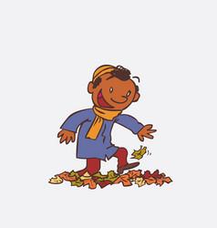 Black child having fun treading autumn leaves vector
